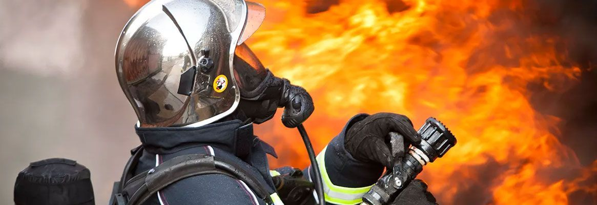 Thermal performance of fire fighters' protective clothing: Numerical study of transient heat and wat