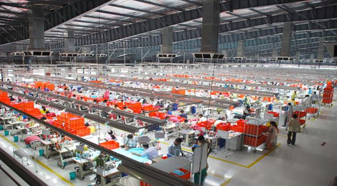 What are the challenges that Indian garment manufacturers face when it comes to adopting sustainable processes and manufacturing products sustainably?