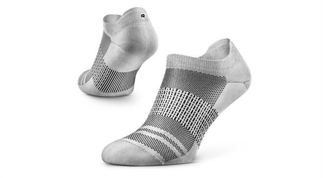 What is the fabric composition of the socks made at Rockay? How different are these from the ones made from virgin fibres?