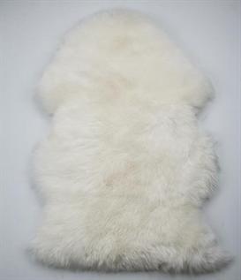 genuine sheepskin , handmade, soft and warm rug