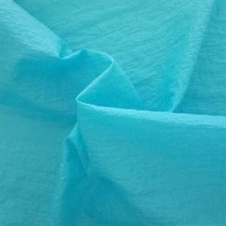 105-115,  100% Polyester, Greige, Weft Knit