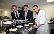 Andy Burnham (C) at the opening of the textile testing lab