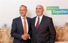 Werner Baumann (L), CEO of Bayer AG, & Hugh Grant, Chairman & CEO of Monsanto.