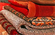 Smriti Irani resolves cutting of carpets issue at ports