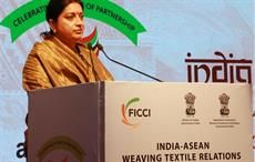 Indian minister for textiels Smriti Irani addressing at the Fabric Show of India-ASEAN Weaving Textiles Relations. Courtesy: PIB