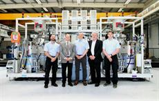 Members of AMRC's Composite Centre and KraussMaffei in front of bespoke KraussMaffei RimStar Compact HP-RTM. Courtesy: AMRC