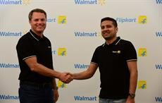 Walmart president and CEO Doug McMillon (left) with Binny Bansal, Flipkart's co-founder and group CEO. Courtesy: Walmart