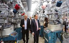 Dimitry Kumsishvili (wearing tie) and Mikheil Khidureli taking a tour of the new factory. Courtesy: Ministry of economy and sustainable development of Georgia
