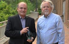 Unifi CEO Kevin Hall (left) and Al Segars of UNC.  Courtesy: Unifi
