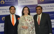 RIL chairman Mukesh Ambani (right) with wife Neeta Ambani and son Anant Ambani at the 41st AGM of RIL. Courtesy: RIL