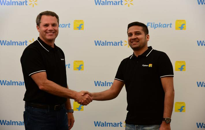 Walmart president and CEO Doug McMillon (left) with Binny Bansal, Flipkart