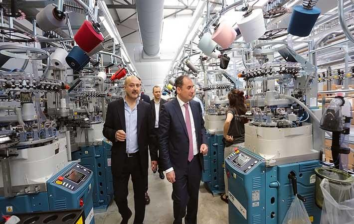 Dimitry Kumsishvili (wearing tie) and Mikheil Khidureli taking a tour of the new factory. Courtesy: Ministry of economy and sustainable development of Georgia