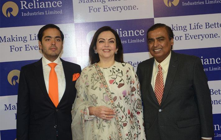 RIL chairman Mukesh Ambani (right) with wife Neeta Ambani and son Anant Ambani at the 41st AGM of RIL. Courtesy: RIL
