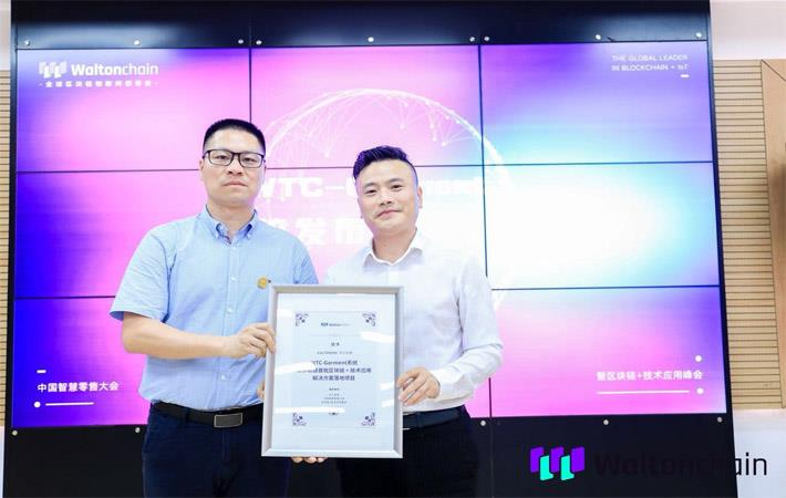 Waltonchain COO Monitor Chan (left) with director of Kaltendin Product Centre, Zhang Zhengxiong. Courtesy: PRNewswire/Waltonchain