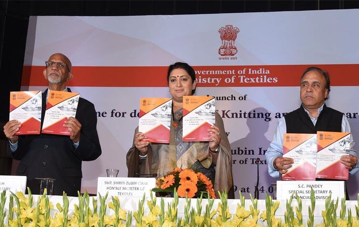 Union textiles minister Smriti Irani releasing the publication at an event to launch the schemes for development of knitting and knitwear sector. Pic: PIB