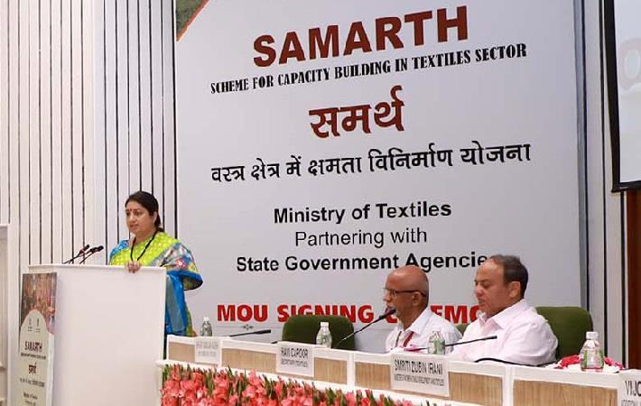 Union textiles minister Smriti Irani addressing at the MoU signing ceremony of her ministry with 18 state governments to provide skill training under
