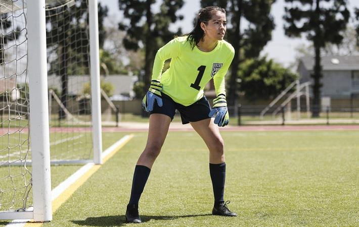 Soccer goalie preparing to stop a shot while wearing a decorated jersey from A4. Pic: A4