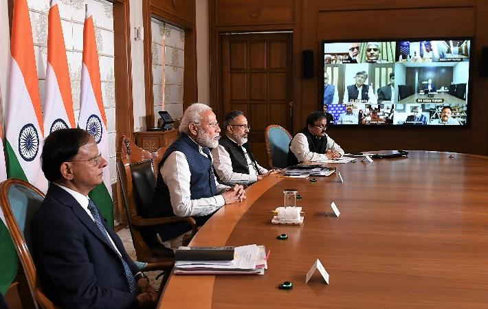PM Narendra Modi interacting with the industry representatives via video conference. Pic: PIB