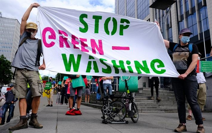 Activists holding placards during a protest by Extinction Rebellion climate change activists in Brussels, Belgium on June 27, 2020. Pic: Alexandros Michailidis / Shutterstock.com