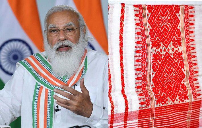 Indian Prime Minister Narendra Modi and Gamusa (right) bought by him. Pic: PIB & asomi.biz