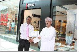 ecco steps up to receive an award from MCC