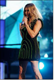 Fergie sporting dynamic luminous dress at Billboard Awards