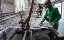 Optimal design of an Indian carpet weaving loom structure