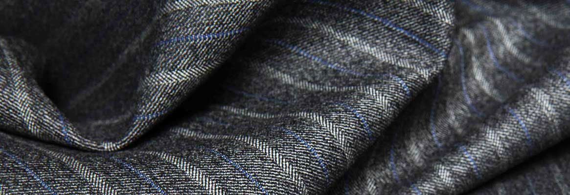 Self cleaning woolen and silk fabrics