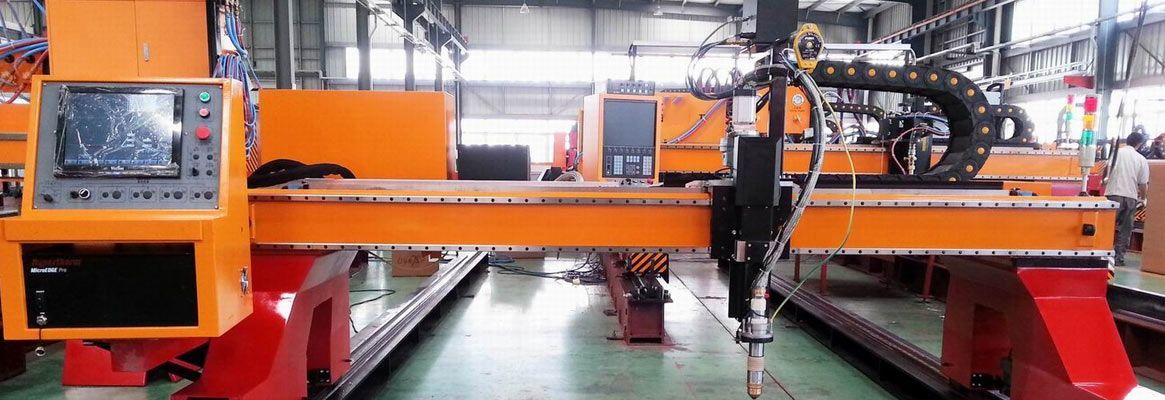 Roll to roll treatment of textiles in industrial plasma batch machines