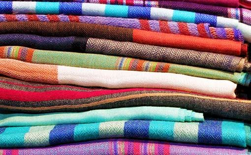 Identification of type of size in woven fabrics
