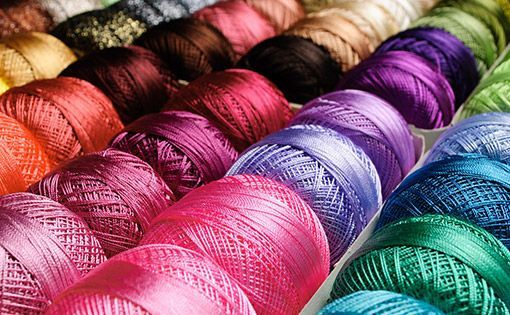 Effect of draw winding process parameters on yarn properties