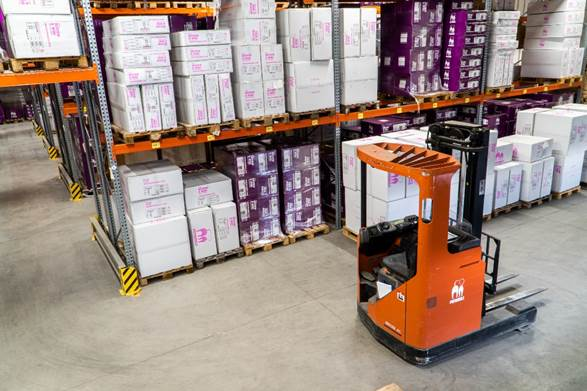 A picture containing text, floor, indoor, warehouse  Description automatically generated